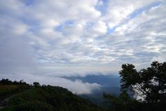 Mountain landscape with wave of fog and dark cloudy sky on the t Stock Photo