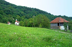 Mountain landscape with white country church, Serbia Stock Photo