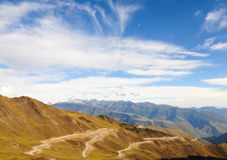 Mountain landscape with white sutra streamer scattered on the gr Royalty Free Stock Photography