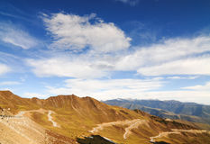 Mountain landscape with white sutra streamer scattered on the gr Stock Photos