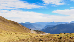 Mountain landscape with white sutra streamer scattered on the gr Royalty Free Stock Photos