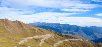 Mountain landscape with white sutra streamer scattered on the gr Stock Image