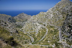 Mountain landscape with winding road Royalty Free Stock Images