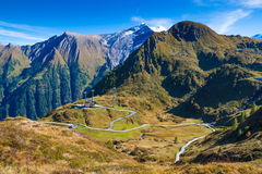 Mountain landscape. With a winding road under the blue sky stock photo