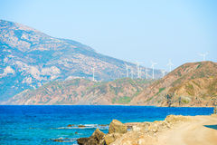 Mountain landscape and windmills Stock Photos