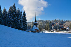 Mountain landscape in winter, with a church and forest Stock Photo