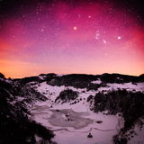 Mountain landscape in winter by night - Fundatura Ponorului, Rom Royalty Free Stock Photo