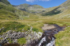 High altitude. Summer landscape in Fagarasi Mountains, landmark attraction in Romania Stock Photos