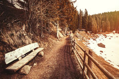Mountain landscape, wooden bench and trail Royalty Free Stock Photo
