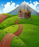 Mountain landscape with wooden cabin at the hills Stock Image