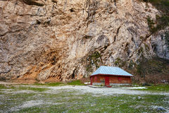 Mountain landscape with wooden house Stock Photography