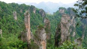 Mountain landscape of Zhangjiajie park with stone pillars and rock formations. Amazing view of mountain landscape with stone pillars and rock formations in stock video