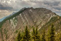 Mountain landscape, Canadian Rockies. Mountain landscapes in Banff National Park. ominous skies, sheer mountains walls, deep valleys royalty free stock photography