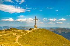 Caraiman Cross in Bucegi mountain. Mountain lanscape in Bucegi with biggest cross in Europe up on a mountain royalty free stock image