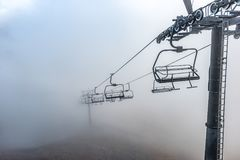 Mountain lift from Kasprowy Wierch to Gasienicowa valley in autumn cloudy day, Tatra Mountains Royalty Free Stock Image