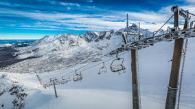 Mountain lift from Kasprowy Wierch to Gasienicowa valley in winter, Tatra Mountains Stock Photos