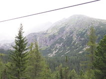 Mountain lift wire. A wire of a mountain lift cabin, a mountain summit in the background Stock Photography