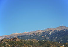 Mountain line with wind turbines Royalty Free Stock Photography