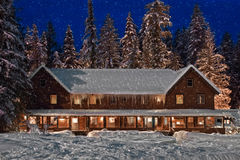 Mountain Lodge. Twilight snowfall at mountain lodge Stock Photography