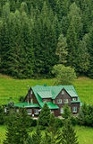 Mountain lodge in summer stock image