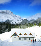 Mountain lodge in winter snow Royalty Free Stock Photos