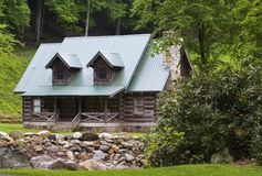 Mountain Log Cabin. Log Cabin in the Mountains, by a Creek Stock Photo