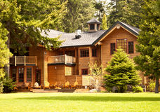 Mountain Log Cabin. In the pine trees Royalty Free Stock Image