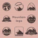 Mountain logo on the cardboard texture. Royalty Free Stock Photos