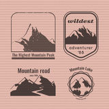 Mountain logo on the cardboard texture. Stock Images