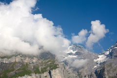Mountain, low clouds and bird flying. Landscape with mountain, low clouds and bird flying stock images