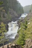 Mountain low waterfall with a rapid current. Beautiful mountain low waterfall with a rapid current in Karelia royalty free stock photo