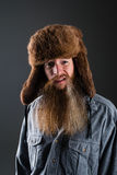 Mountain man with a sneer. Mountain man in a fur hat with a sneer on his face stock photos