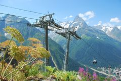 The mountain massif of Dombai. Cable car a cable car in the ski resort of Dombay Stock Photos