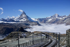 Mountain Matterhorn with clear blue sky and mist below, Zermatt, Switzerland. The rail road with Mountain Matterhorn with clear blue sky and mist, Zermatt Royalty Free Stock Photos