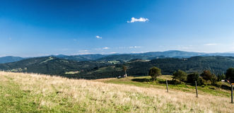 Mountain meadow with hills on the background Royalty Free Stock Photos