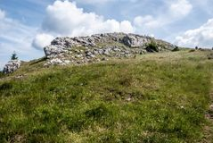 Mountain meadow with small rocks and blue sky with clouds. On Skalky hill in Lucanska Mala Fatra mountains in Slovakia Stock Images