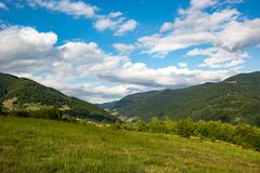 Mountain meadow under clouds in sky. Nice mountain meadow under clouds in sky, Carpathians Royalty Free Stock Photos