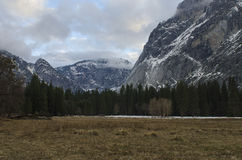 Mountain Meadow in Winter. A scenic view of a high mountain meadow in winter under cloudy skys in Yosemite National Park Stock Images