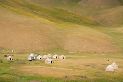 Mountain meadow with the yurts of the farmers Royalty Free Stock Images