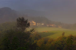 Mountain and meadows near Bajina Basta, Western Serbia. Autumn picture. Amazing myst picture with sunny light, beautiful soft colors, houses on the hill Stock Image