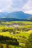 Mountain meadows and villages Stock Photos