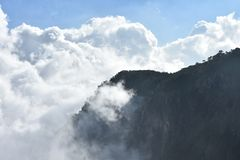 Mountain meets clouds. Clouds meets the mountains  on a beautiful morning Stock Photo