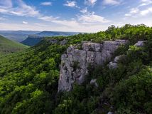 Mountain in the midst of green trees. Crimea in summer.  royalty free stock photo