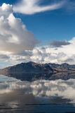 Mountain mirror image. Mirror image of mountains and sky in the rain soaked Bonneville Salt Flats, Utah Stock Photos
