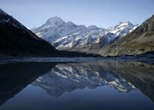 Mountain mirrored in lake. Mount Cook in New Zealand is a beutiful place to visit Royalty Free Stock Images