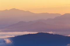 Mountain and mist in morning Stock Photos