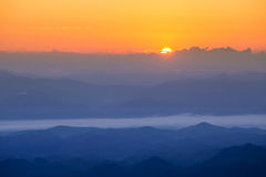 Mountain and mist in morning Stock Images