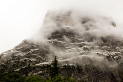 Mountain in the mist Stock Images