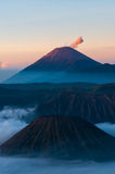 Mountain in mist and smoking Volcano Bromo Royalty Free Stock Image