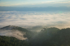 Mountain and mist. Mountain on top the mist stock photography